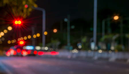 Abstract defocused lights of the night city bokeh background . photo