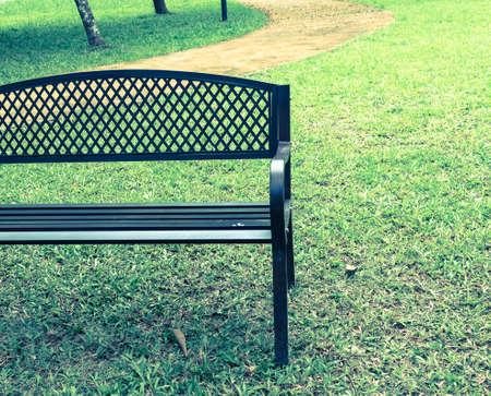 wooden park bench at the public park image. photo