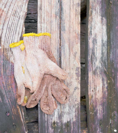 close up shot of dirty gloves on wood table photo