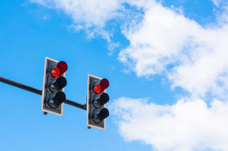 lit image: image of traffic light, the red light is lit. symbolic  for holding.