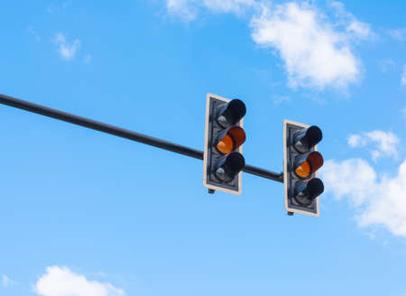 image of traffic light, the amber light is lit. symbolic  for waiting. photo