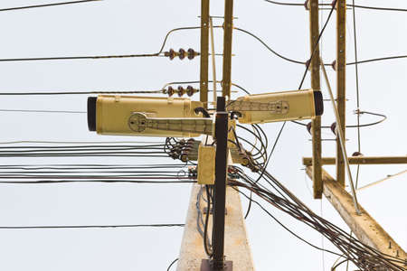 image of cctv camera on electric pole . photo