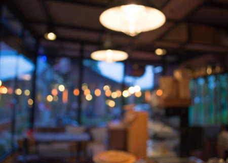 energy bar: Coffee shop blur background with bokeh image.