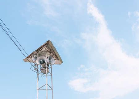 image of many megaphone and blue sky photo