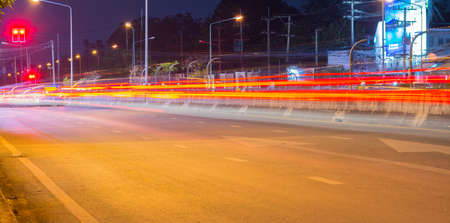 Long exposure photo of light trails on the street in Thailand . photo