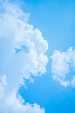 hungry face cloud and blue sky background image. photo