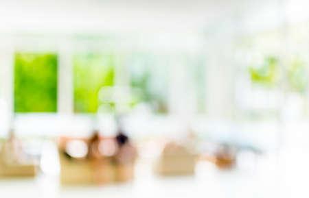 blur image of people sit in living room .