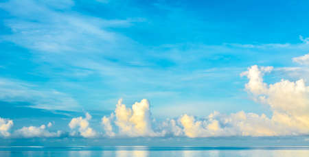 view on sea: image of blue sea and cloudy blue sky over it.