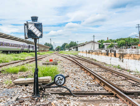 lamp on the pole: image of old  lamp pole on railway  Stock Photo