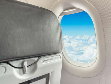 image of  fasten seat belt while seated sign on airplane. Reklamní fotografie