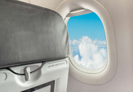 fasten: image of  fasten seat belt while seated sign on airplane. Stock Photo