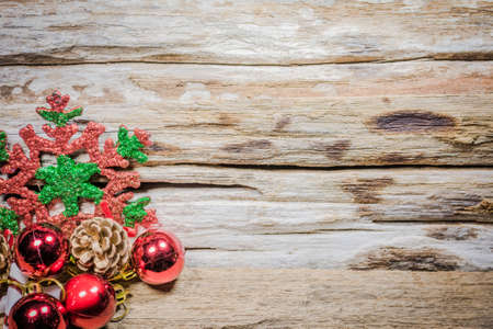 Chrismas baubles and vary of decoration on wood background. Standard-Bild