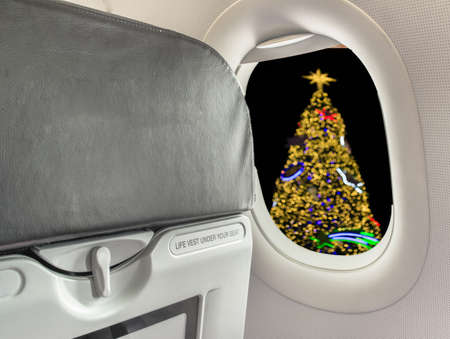 airplane take off: image of  chair on airplane and Christmas tree.