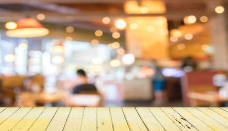 Empty wood table and blurred coffee shop  background . Stock Photo