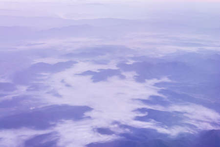 View from the plane window to see the mountain. photo
