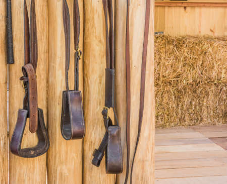blanket horse: riding horse equipment hang on wooden fence
