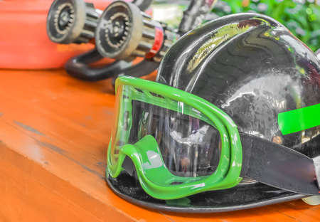 public servants: firemans safety hard hat on the table. Stock Photo