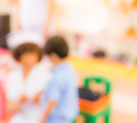 hospital patient: Blurred background : kid Patient and nurse in hospital. Stock Photo