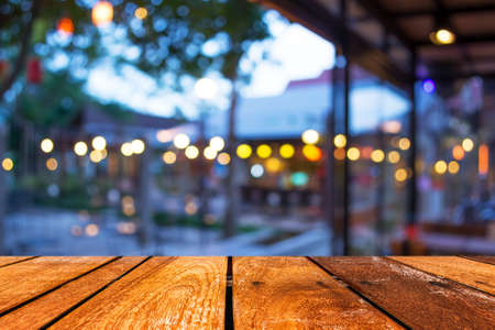 Empty wood table and Coffee shop blur background with bokeh image. Stock Photo