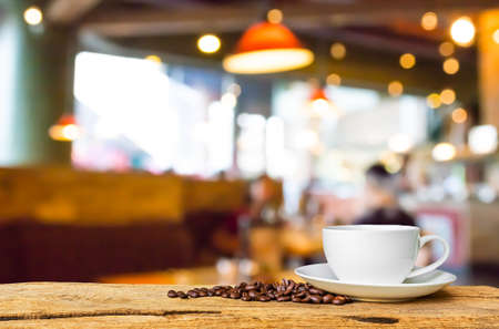 Coffee shop blur background with bokeh image . Stock Photo