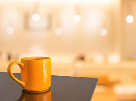 interior layout: Empty wood table and Coffee shop blur background with bokeh image. Stock Photo