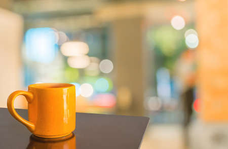 furniture shop: Empty wood table and Coffee shop blur background with bokeh image. Stock Photo