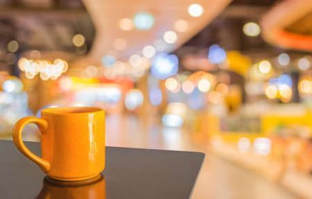 Empty wood table and Coffee shop blur background with bokeh image. photo