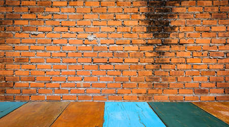 vignetted: red brick wall texture grunge background with vignetted corners of image.