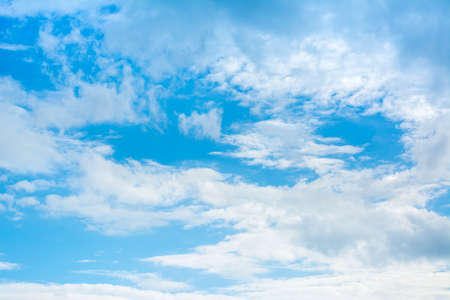 nimbi: image of clear sky with white clouds on day time for background usage . Stock Photo