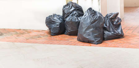 image of waste black bag on the floor Stock Photo