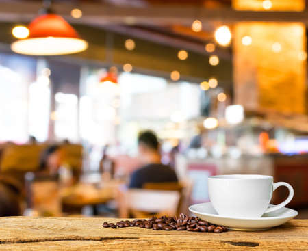 night table: Coffee shop blur background with bokeh image . Stock Photo
