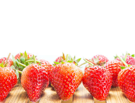 fresh strawberry on wood table isolated on white background . photo