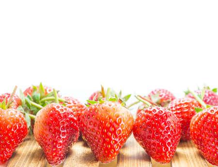 fresh strawberry on wood table isolated on white background . photo