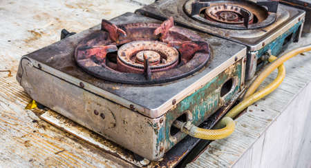 old gas stove: image of Old gas burner and stove close up. Stock Photo