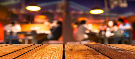 empty brown wooden table and  Coffee shop blur background with bokeh image. photo