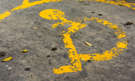 handicapped: image of old Handicapped symbol on parking space.