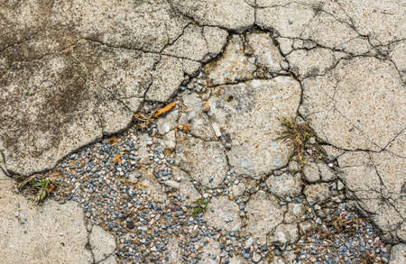 image of small pebble rock on cracked cement ground  texture for background usage . photo