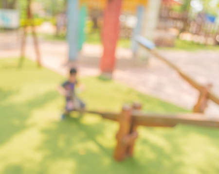 Defocused and blur image of childrens playground at public park for background usage. photo