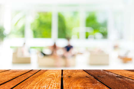 Empty wood table and Coffee shop blur background with bokeh image. 写真素材