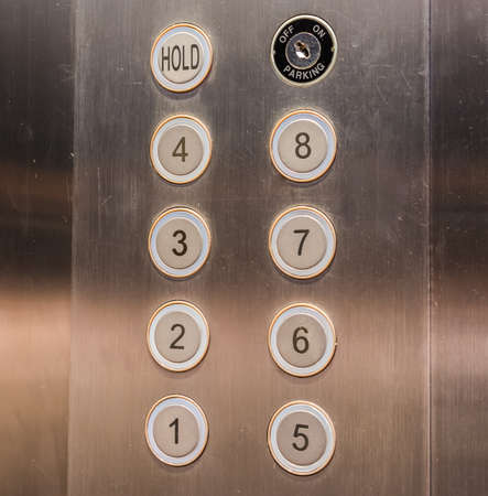 elevator inside buttons. image of stainless steel elevator panel push buttons. photo inside buttons e