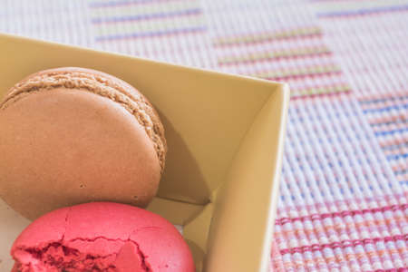tela algodon: Sweet and colourful french macaroons on cotton cloth background .