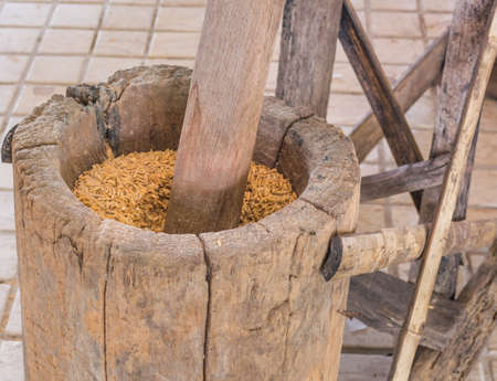 rice mill: Thai style hammer of rice mill made from wood. Stock Photo