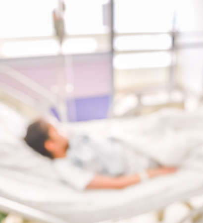 blurred image of Patient with drip in hospital for background usage. Stock Photo