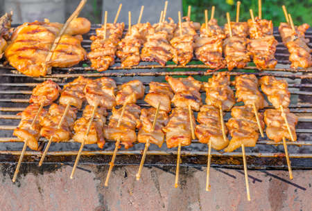 image of Traditional roasted pork stick on grill, Thailand. photo