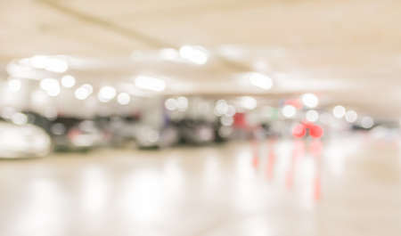 car park interior: blur image with bokeh of Car park interior for background usage. Stock Photo