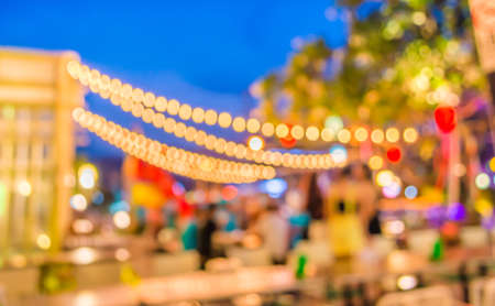 Artistic style - Defocused night street abstract texture ,blurred background with bokeh of  city on street at night.