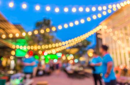 芸術的なスタイル - 多重夜通り抽象的なテクスチャ、夜市路上のボケ味を持つ背景をぼやけています。 写真素材