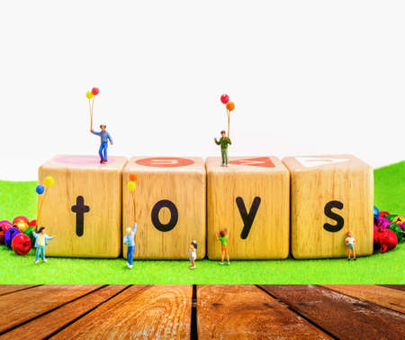 wooden figure: image of mini figure kids dolls hold balloon playing on toys wooden  blocks isolated on white background.