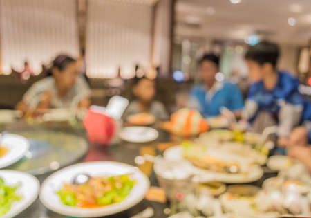 Chinese restaurant blur background with bokeh image . Stock Photo