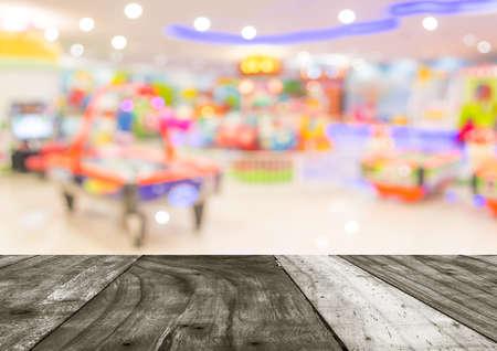 Arcade game machine shop blur background with bokeh image .